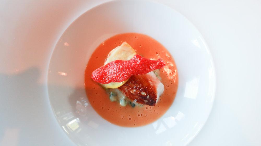 "Alaskan King Crab ""a la plancha"" with garden summer squash, marscapone enriched Anson Mills polenta, Roma tomato confit, and creamy lobster broth"