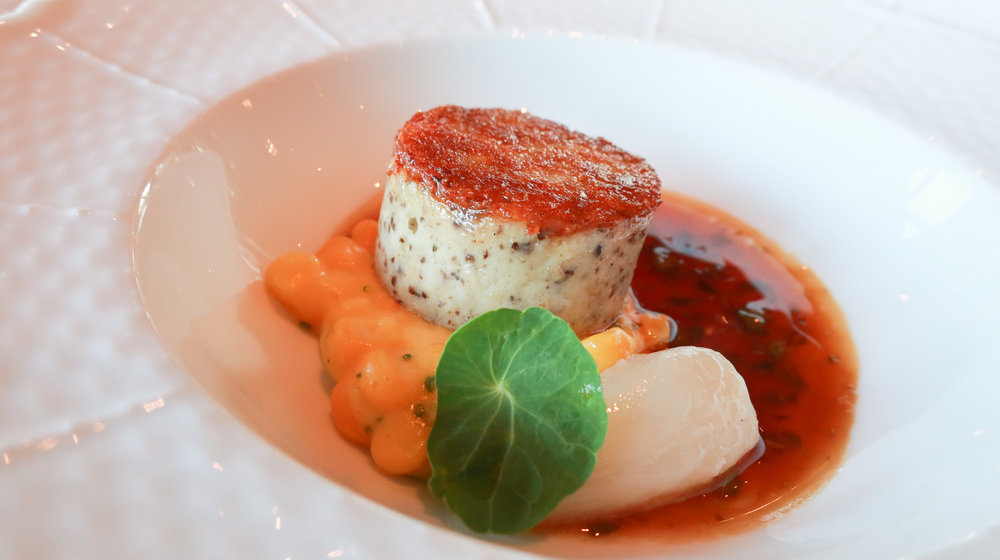 """With creamed Brentwood corn, glazed garden turnips, La Ratte Potato Puree, and caper-brown butter """"consomme"""""""