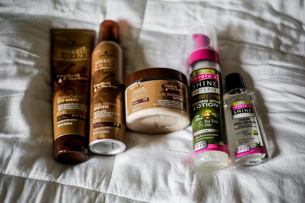 Pictured here: Quench Co-Wash, Curl Defining Mousse, Curl Hyrating Butter, Foam Wrap Lotion, & Hair Polisher.