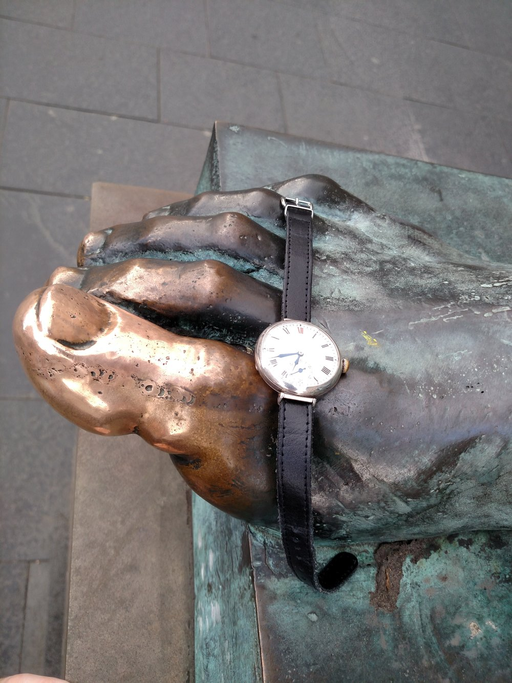 1923 Longines on the toe of David Hume's statue  The Royal Mile, Edinburgh, Scotland