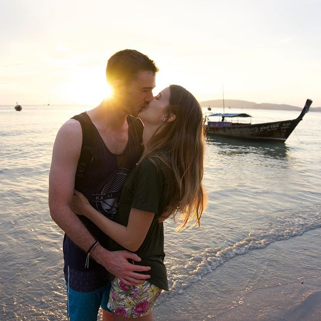Day 214: Christmas kisses in Thailand. 🎄❤🌴 For the past two weeks, we've been traveling around southern Thailand for the holidays. Our families came to visit and it's been so much fun sharing our travels with them. Today we watched the sunset on Ao Nang Beach after a boat trip to Railay Beach. The pastel colors in the water were unreal! Check out @expedia's stories for the highlights. Looking forward to ringing in the new year in this beautiful place. #365daysoftravels