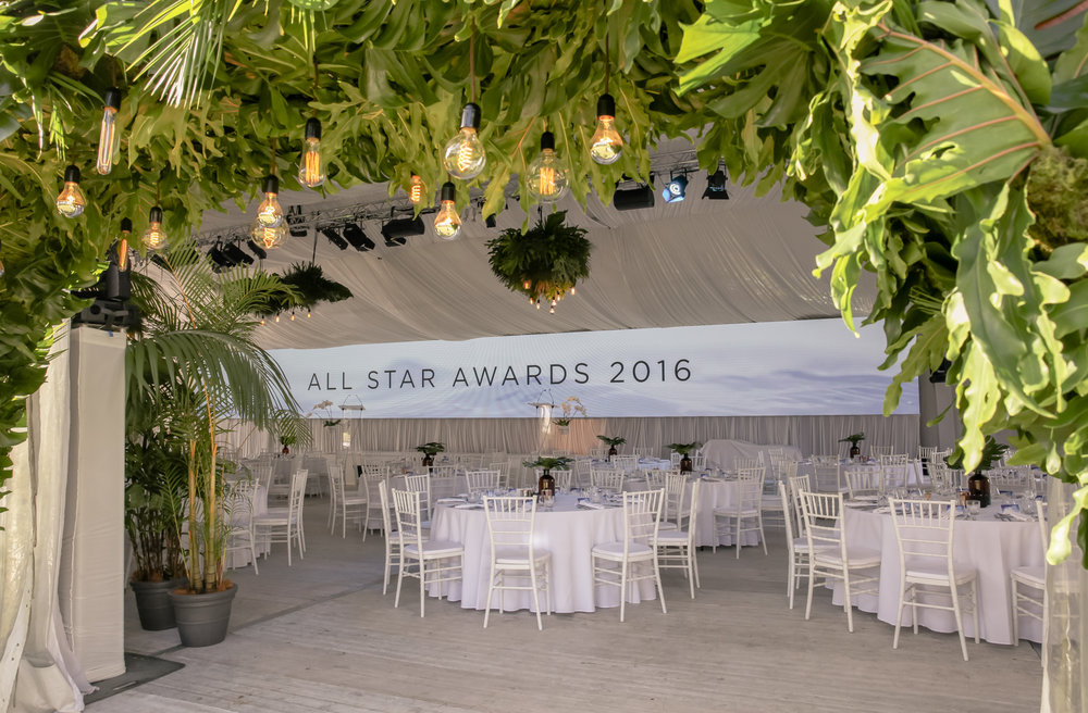 Covered archway and hanging foliage chandeliers for Unicorn Group awards gala dinner at Elements of Byron resort