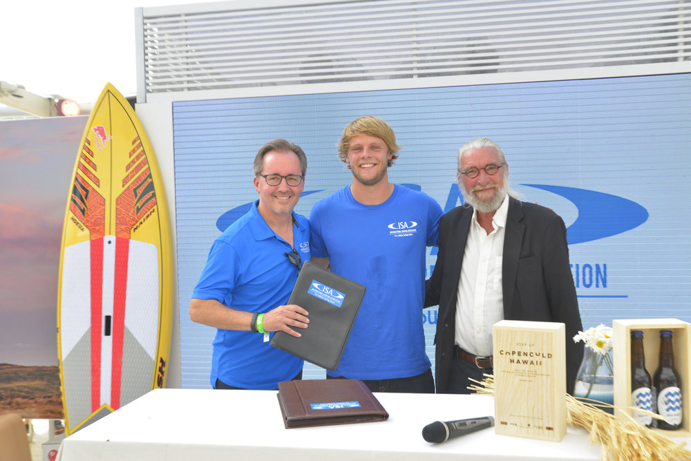 Finn Jorsal (left), president of Friends of Cold Hawaii, and Robert Fasulo (right), executive director, ISA, and Casper Steinfath (middle), ISA and Cold Hawaii, in the Danish National House in Rio, after signing the COPENCOLD HAWAII – ISA World StandUp Paddle and Paddleboard Championship 2017 hosting agreement.