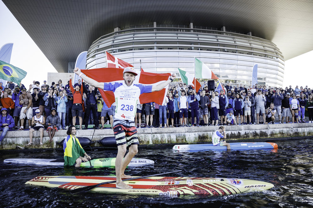 Local sensation, Casper Steinfath overcame a second-place finish in the semi-final to deliver a commanding gold-medal performance in the 200-meter SUP Sprint Race Final. Photo: ISA / Ben Reed.