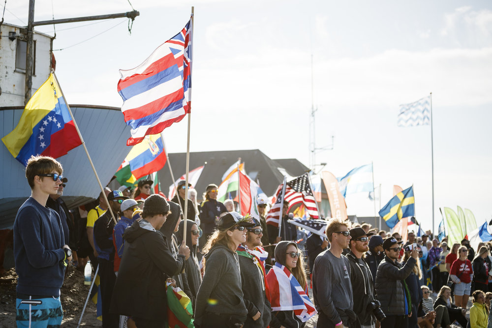 42 nations gather at the Welcome Ceremony at the competition site of the SUP Surfing, Technical Races, and Relay Race in Vorupør.  Photo:  ISA / Ben Reed