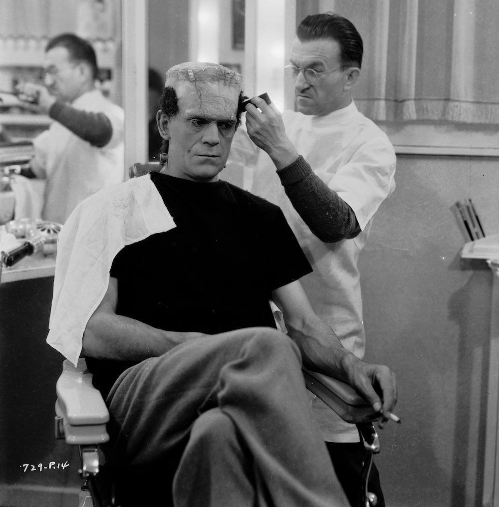 Jack P. Pierce preps Boris Karloff's hair and makeup for Frankenstein, 1931