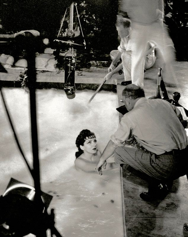Director Cecil B. DeMille with Claudette Colbert on the set of  The Sign of the Cross , 1932