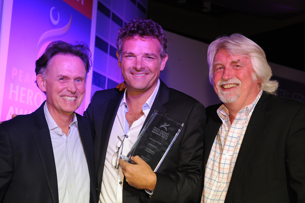 John Barnes (L) and Peter Martin (R) presenting Tim Bacon with the Peach Icon award in 2013