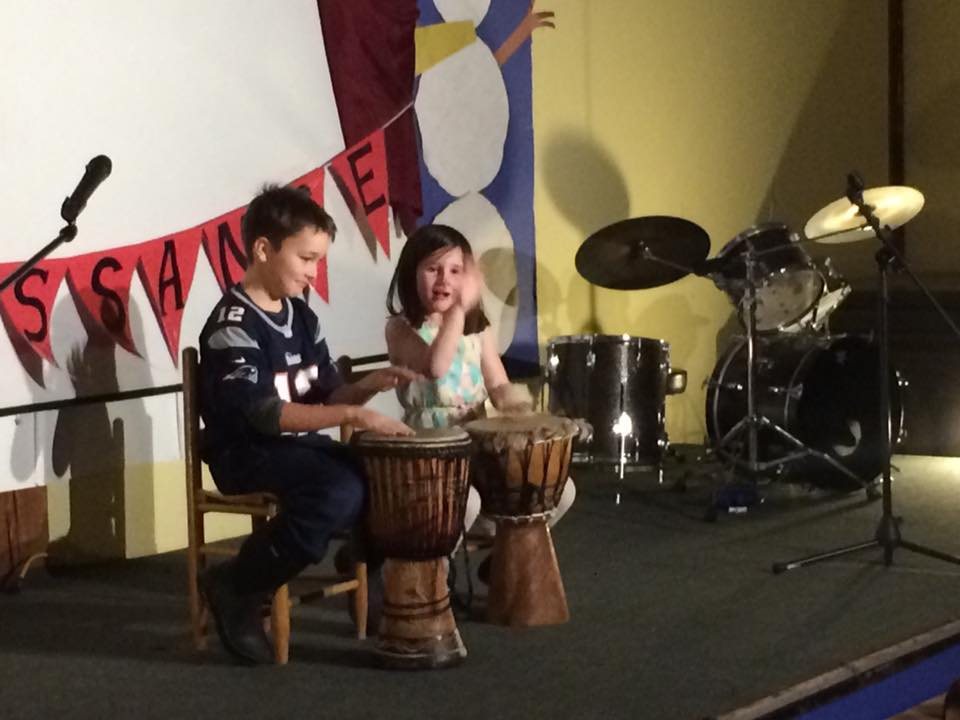 Talent Show drummer with assistance from stage manager.jpg