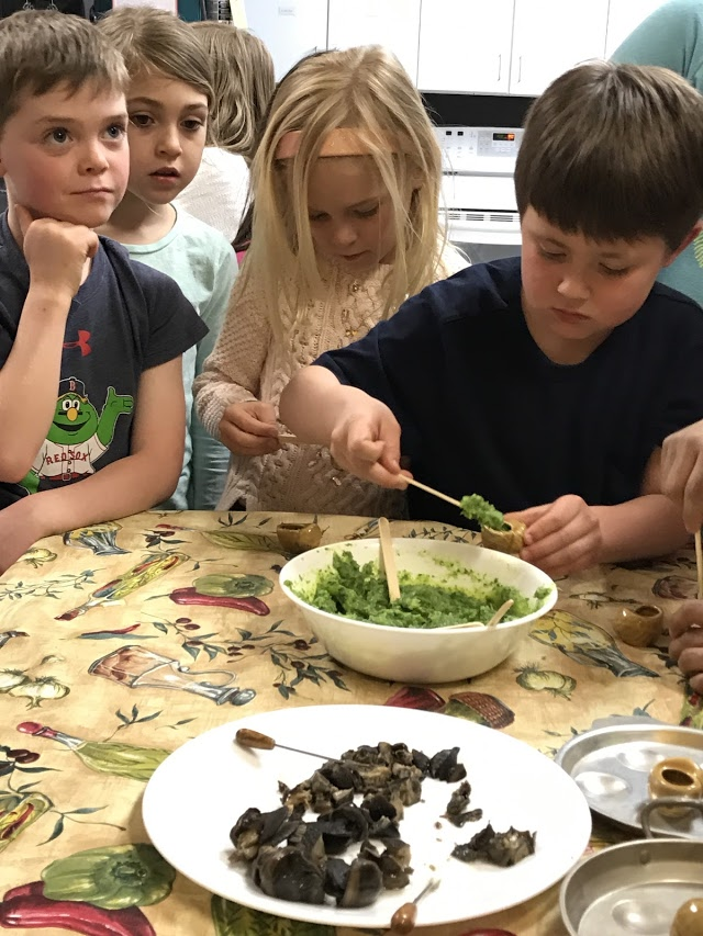 Day in the life 1st grade making escargot in French c lass.jpg