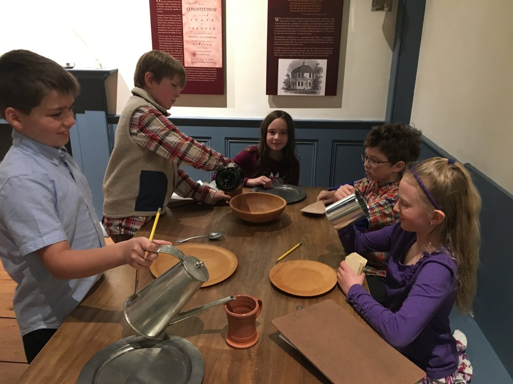 4th grde at VT History Museum pretending to have colonial time meal.JPG