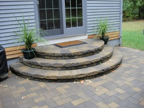 An attractive set of semi-circular steps from Clarke Landscapes on Pinterest.