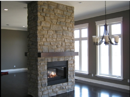 Here is a lovely fireplace done by Reece Masonry. Click  here  to see more samples of their work.