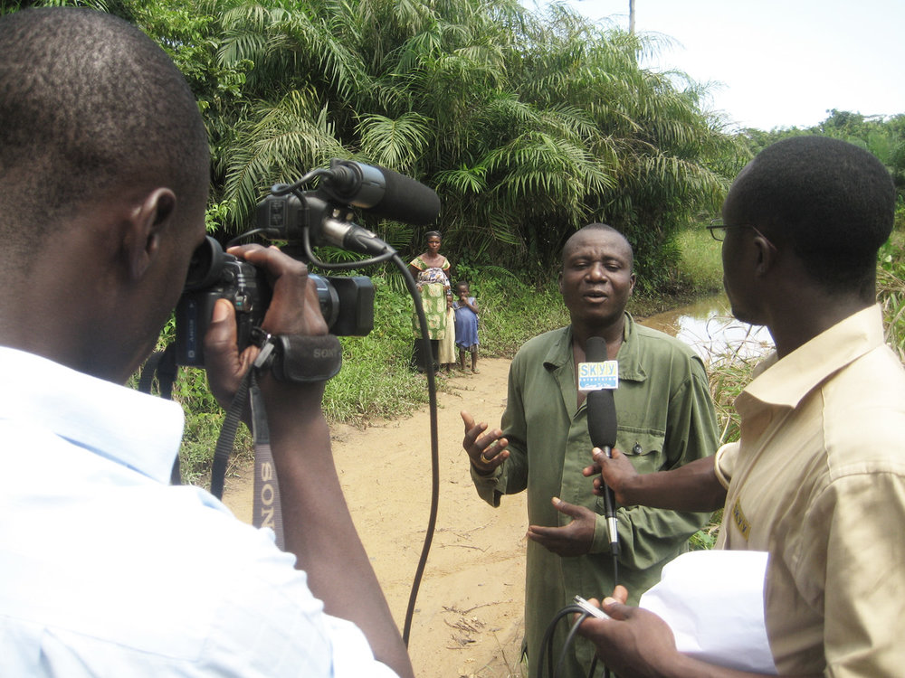 Reporter in Ghana - Photo courtesy of Kevin Hill.jpg