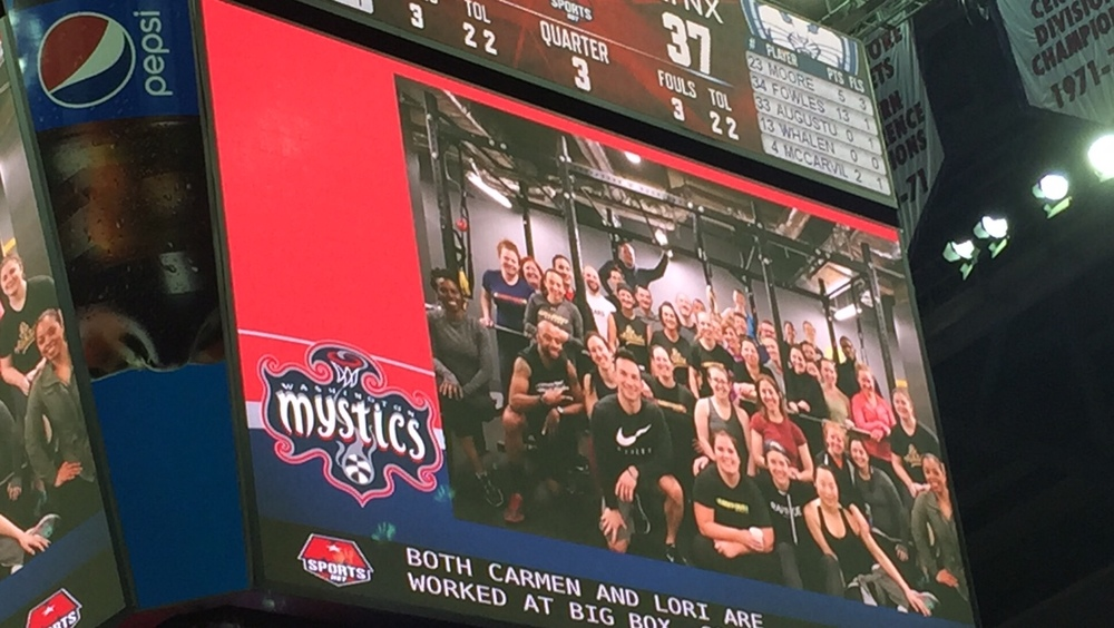 #bettertogether / Fit Fam on the jumbotron.