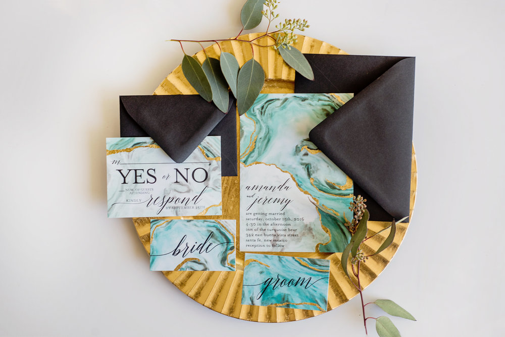 The whole suite was printed on Cotton cardstock and then hand-foiled to create the raw, textured effect. Cotton is a great option for printing, especially for designs that you want to have a watercolor or organic feel to. Paired with jet black envelopes, this suite is a total jaw dropper!