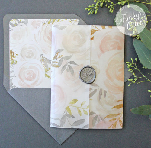 Watercolor floral vellum wrap invitation suite with steel grey wax seal