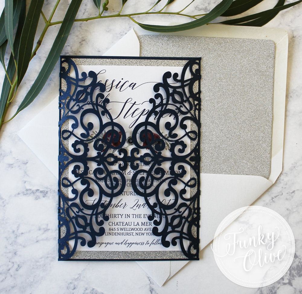NAVY FLORAL LASER CUT INVITATION CLOSED.jpg
