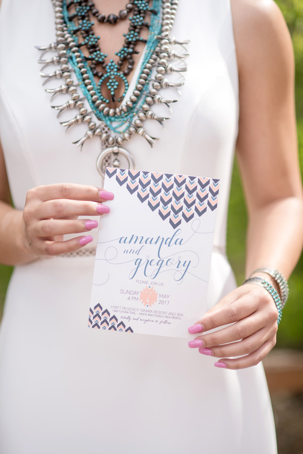 Our lovely model holding one of the southwest chic invitations designed for the shoot - I love all the #bohovibes! That squash blossom necklace is sooooo dreamy.