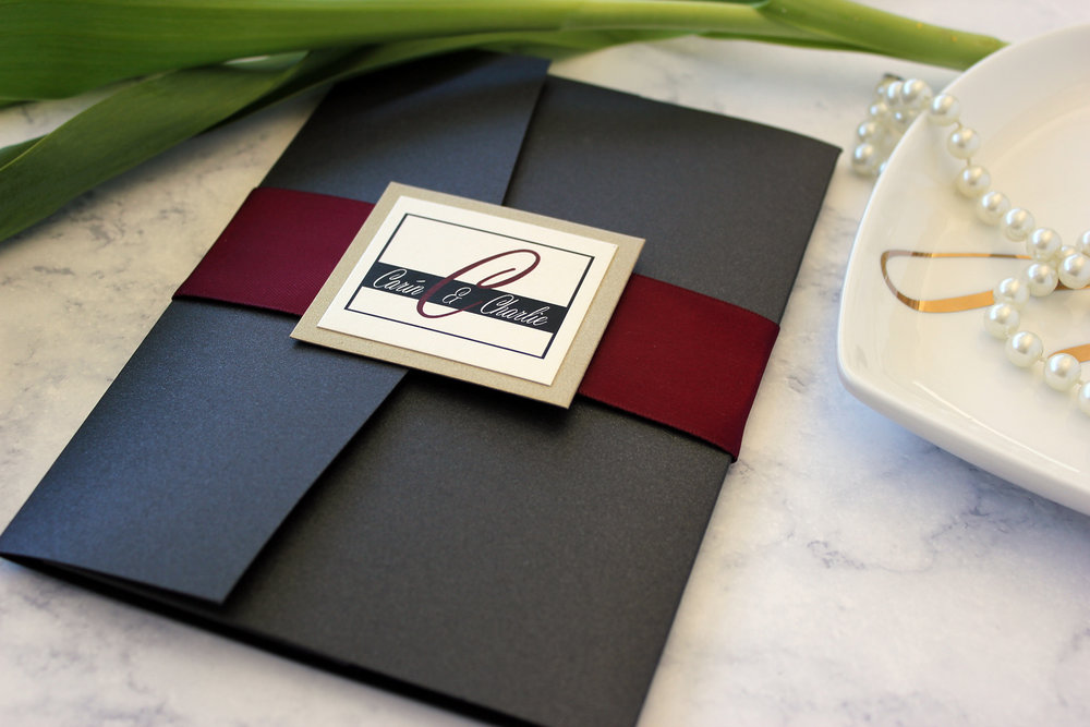 This sophisticated style of band features a deep burgundy satin ribbon band, topped with the couple's monogram and a backing layer of gold leaf cardstock.