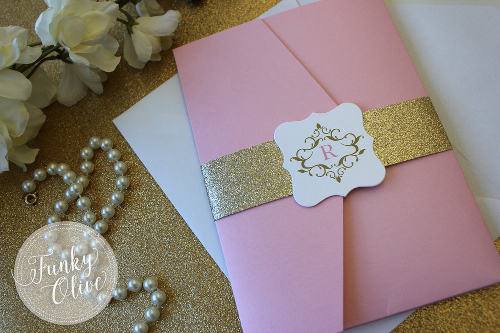 A bright gold glitter band and royal monogram are the perfect pairing for this perfectly pink invitation suite.
