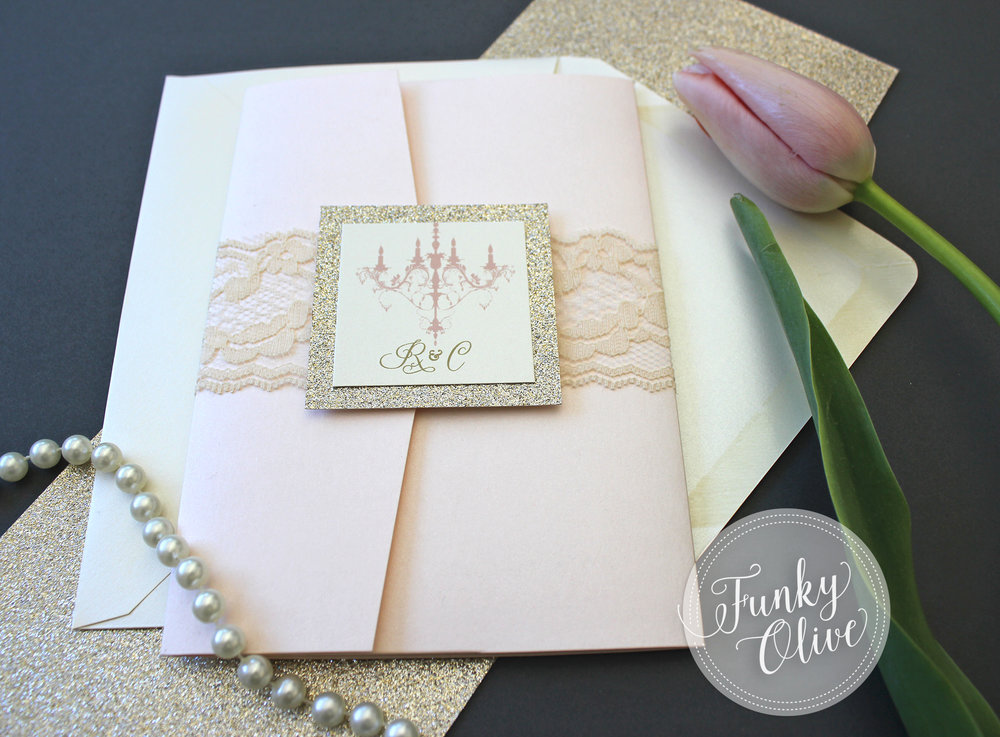 Ivory lace with a champagne shimmer cardstock topper with gold leaf glitter backing was the perfect choice for these blush and gold pocketfold invitations.