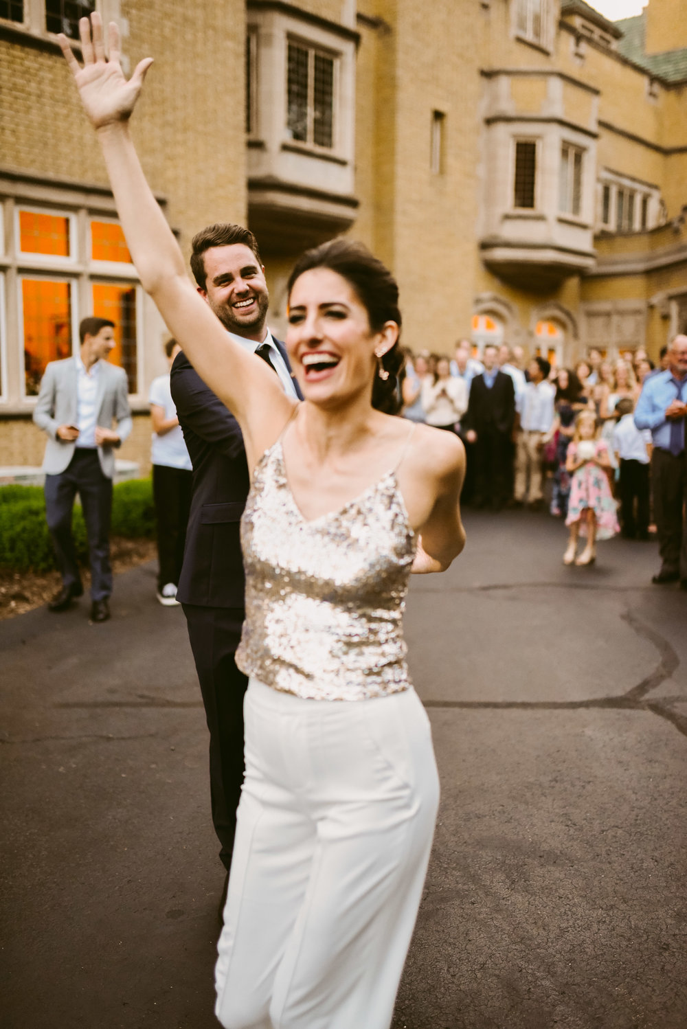 Dancing into their new lives like Heck Yes!!!! Also, can we talk about this outfit change? A super chic pant and sequin tank top? This bride is goals!!!!