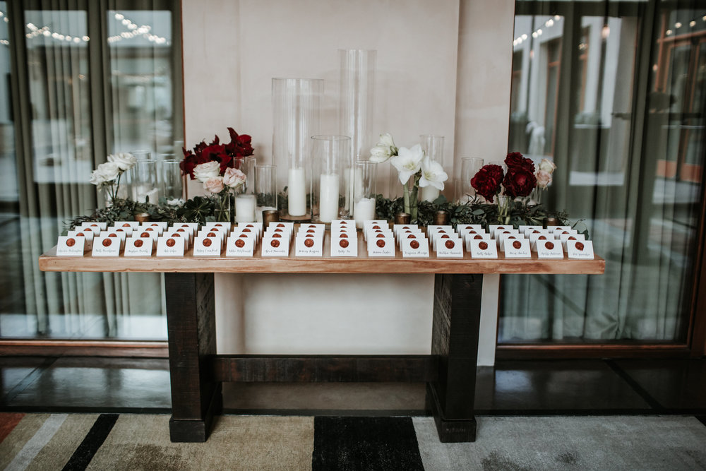 A beautiful escort card display by one of our preferred planners, Alena Swanson along with Floriography Floral. Photo by the amazing Emily Joanne Photography. Location - The Four Seasons, Santa Fe.