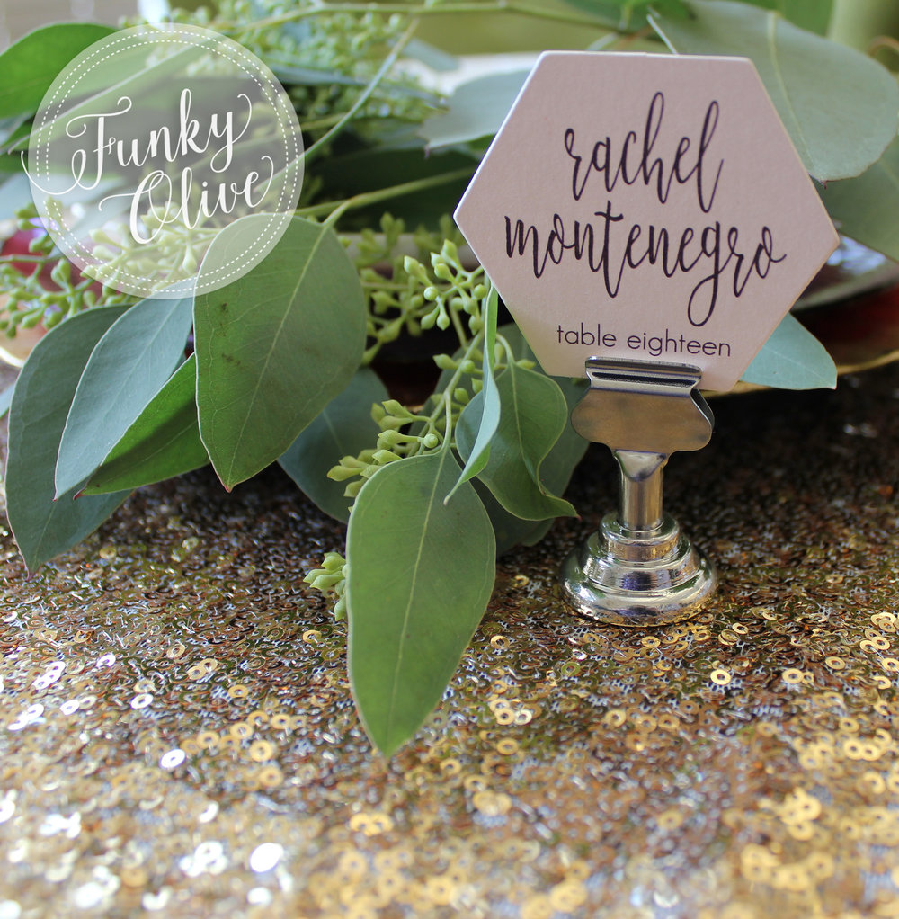 Small, hexagon die cut escort cards, printed on blush shimmer cardstock.
