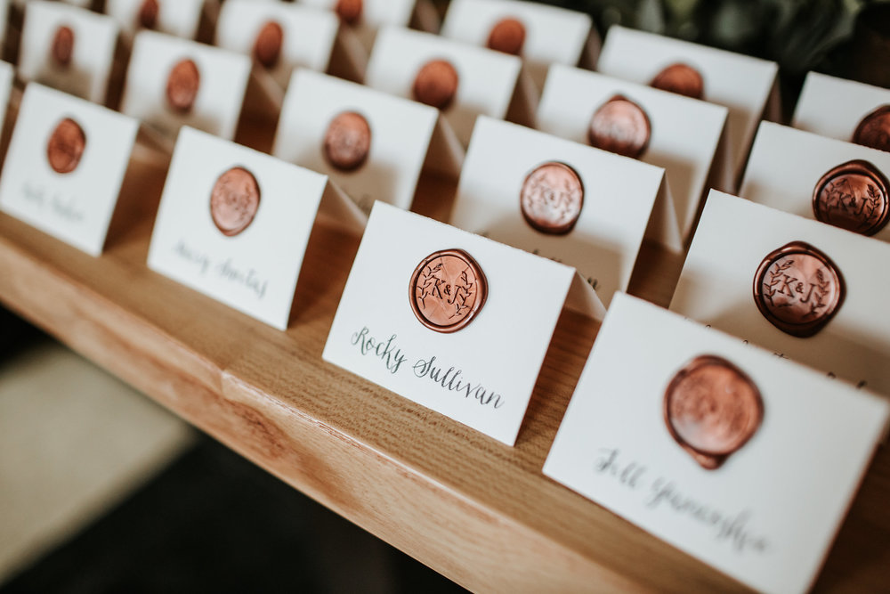 We love when couples choose to use a beautiful wax seal on their place cards! Photo © Emily Joanne