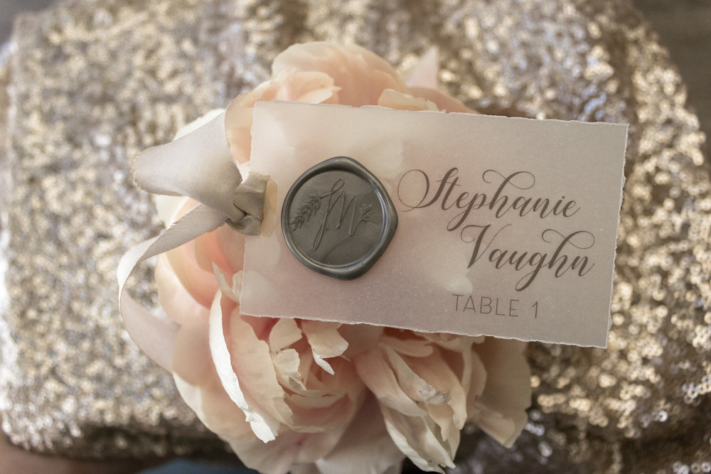 These vellum place cards feature a deckled edge, wax seal and silk ribbon - talk about lovely!!!!