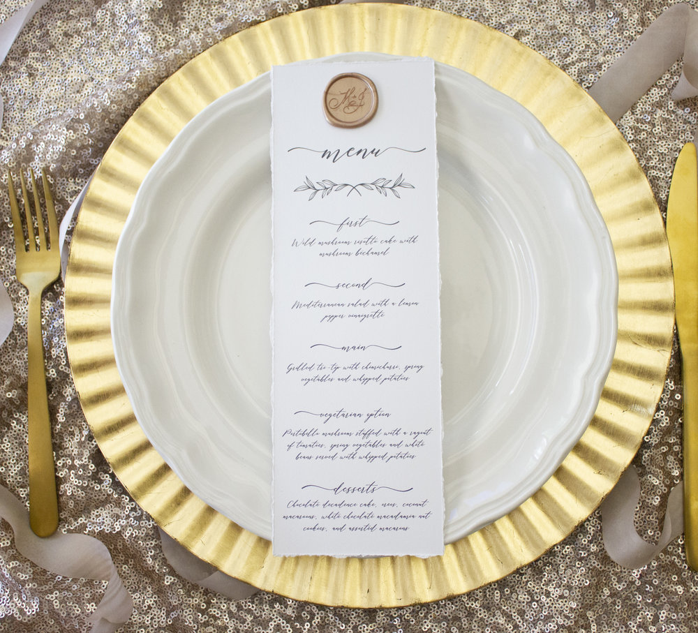 These deckled edge menus just wouldn't be the same without the rose gold wax seal!