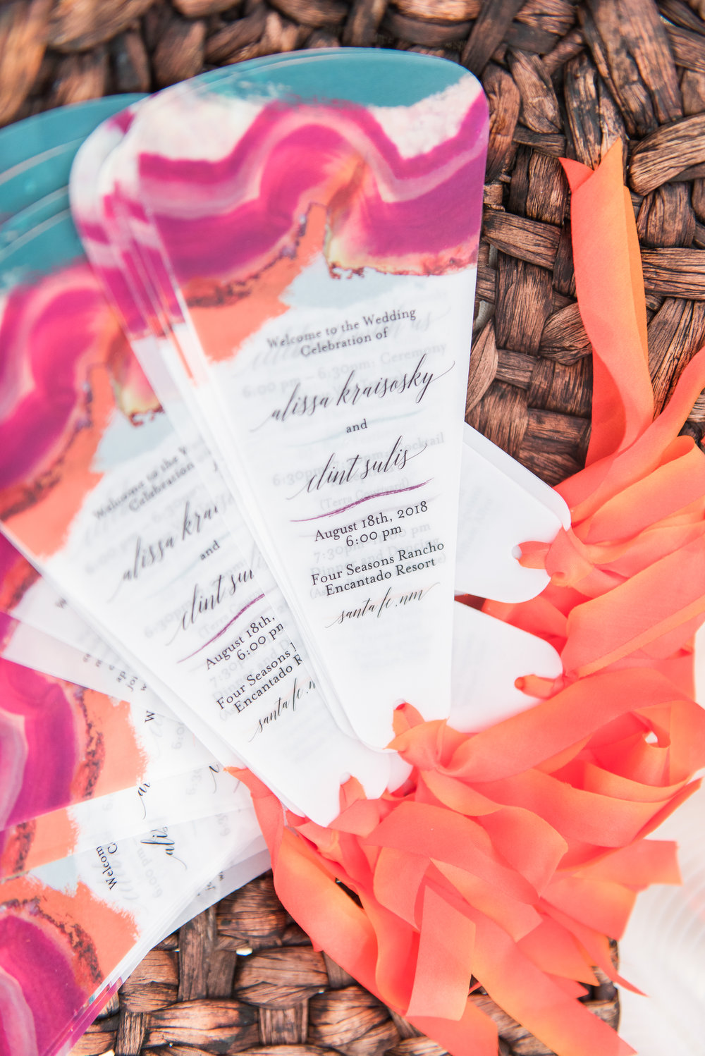 Another little favorite, these vellum ceremony programs - a fan style in the brides' signature bold color palette and the most luscious sunset orange hand dyed silk ribbon. To. Die. For.
