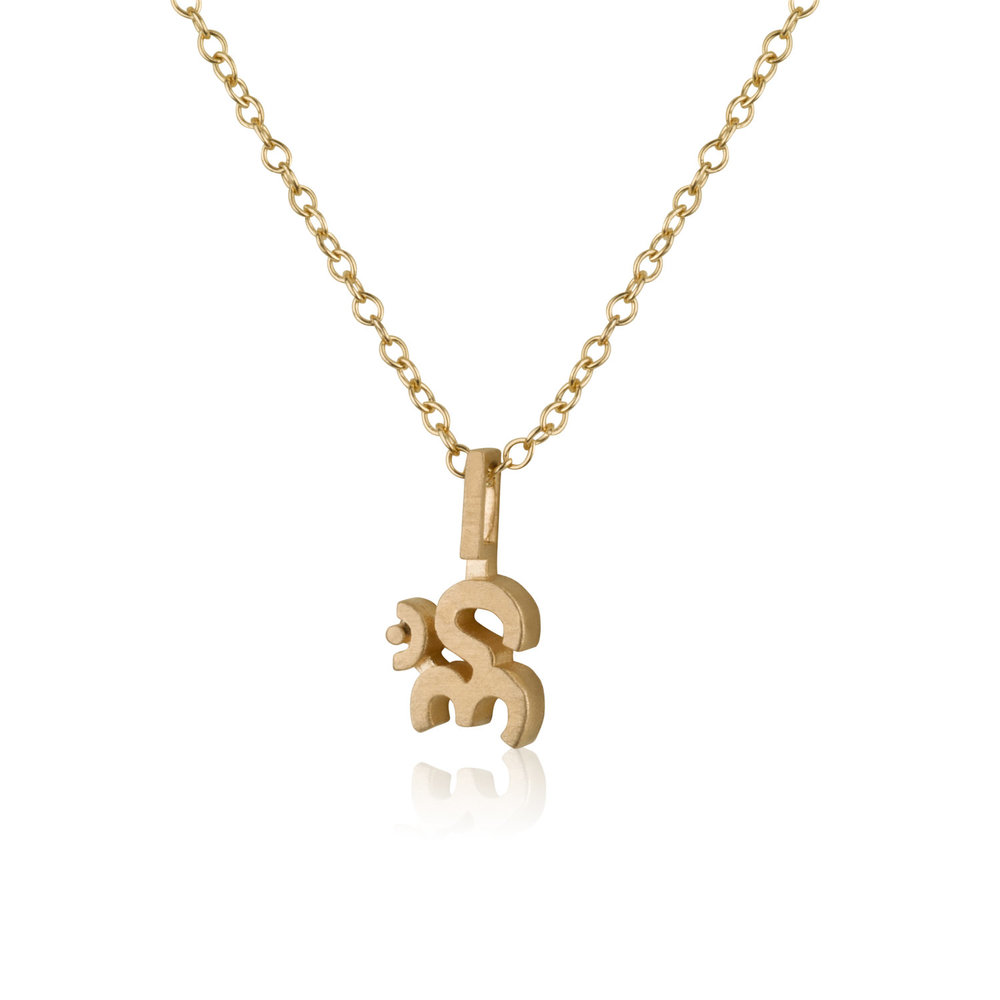 The  Om Necklace  is available in 14K, 18K Yellow Gold or Sterling Silver.