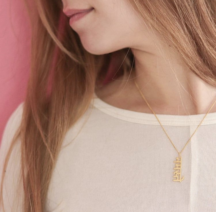 Kerstin  from Germany wears the  Namaste नमस्ते  in 18K gold