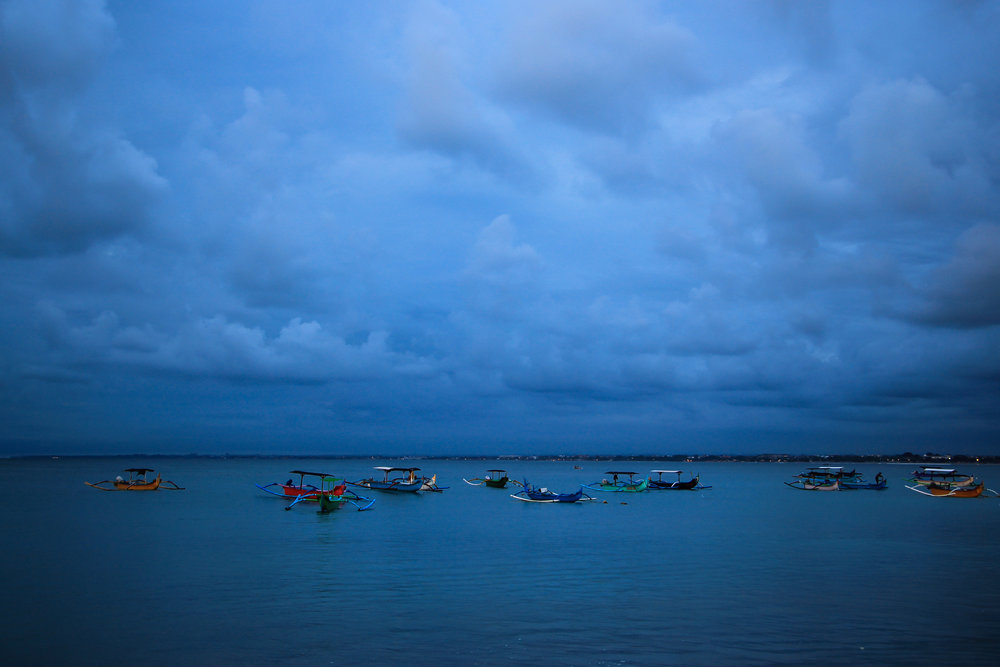 sunset, Sea, fishing boat, blue, storm, Bali, Indonesia, Asia | DoLessGetMoreDone.com |