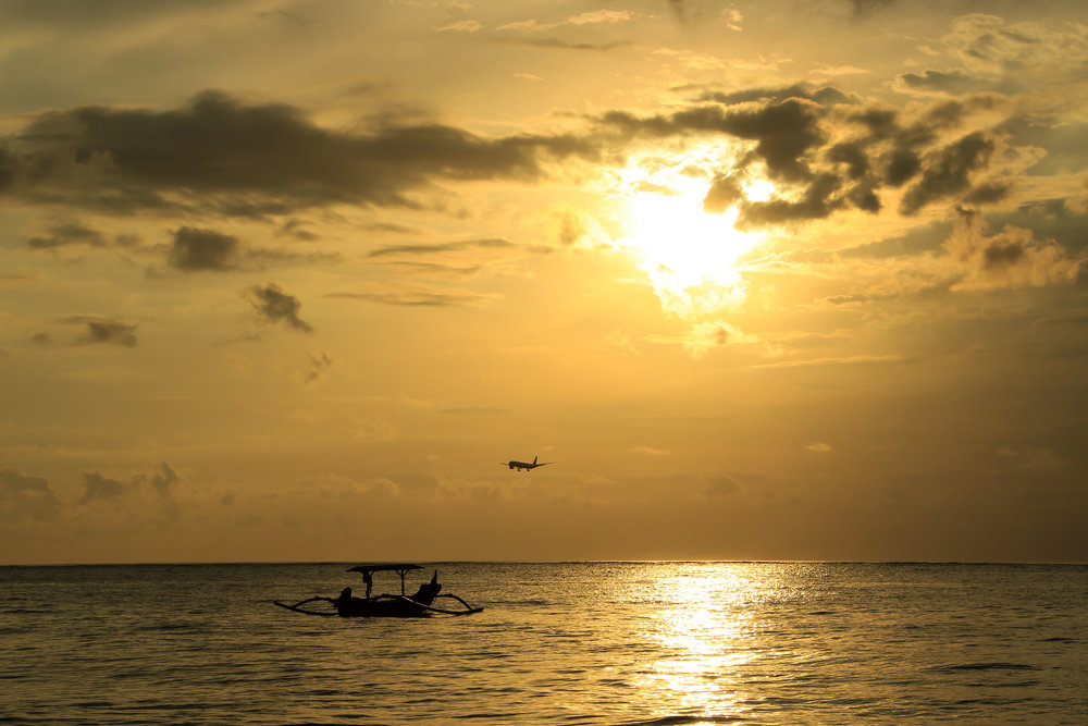 sunset, Sea, Airplane, fishing boat, yellow, Bali, Indonesia, Asia | DoLessGetMoreDone.com |