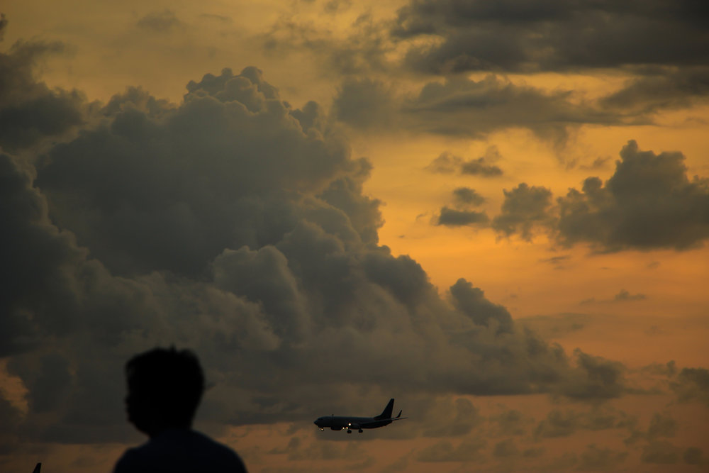 sunset, cloud, airplane, landing, people, Bali, Indonesia, Asia | DoLessGetMoreDone.com |