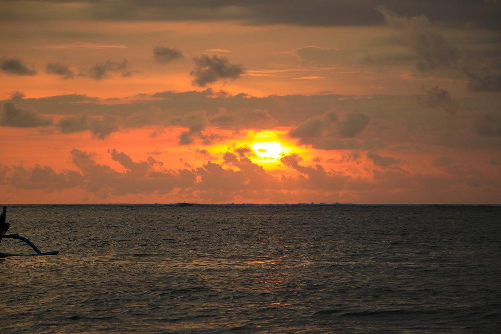 sunset, sky, sun, fishing boat, Bali, Indonesia, Asia | DoLessGetMoreDone.com |
