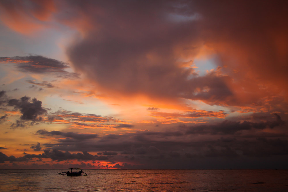 sunset, sky, clouds, sea, fishing boat, Bali, Indonesia, Asia | DoLessGetMoreDone.com |