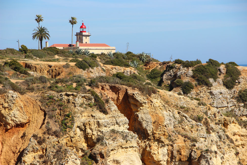 Cliffs in Lagos, Portugal, Europe | DoLessGetMoreDone.com | What can we do to make it better?