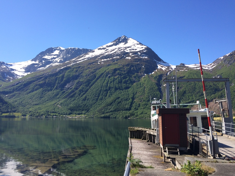 An example of what you might see out the car window in Norway.  On the right is an old ferry that's no longer in use.