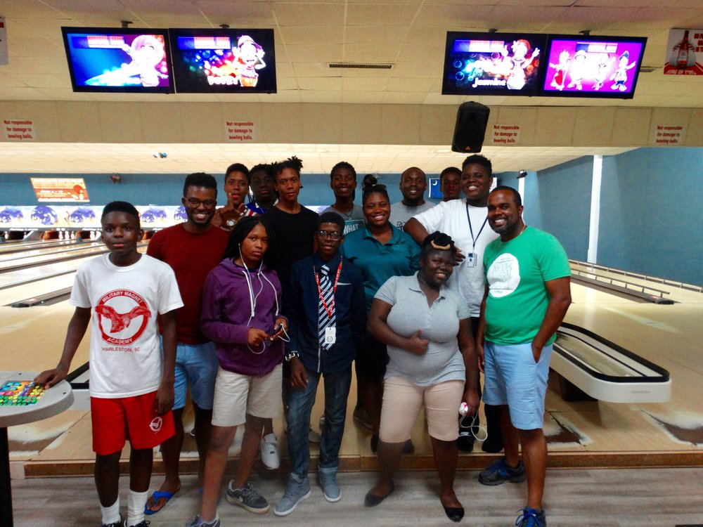 the young leaders of urban hope & metanoia building together during a game of bowling