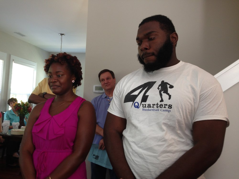 Jennifer Jones (who has family ties to Walltown) & TJ Hearn (who grew up in the neighborhood) stand during The Alexander House blessing on August 16, 2014. They were two of our four initial residents.