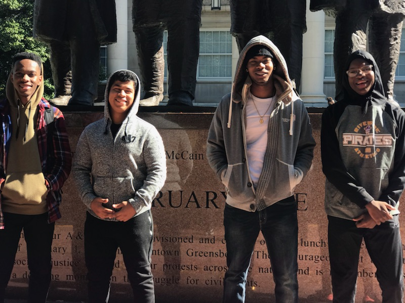 Room to Learn - Demicheal (second from right) on a college tour at NC A&T in Greensboro with juniors and seniors from Urban Hope's Young Leaders Group. A monthly gift of $50 supports him as he meets weekly with neighborhood youth Darrin and Fred to navigate life as black boys in Walltown.