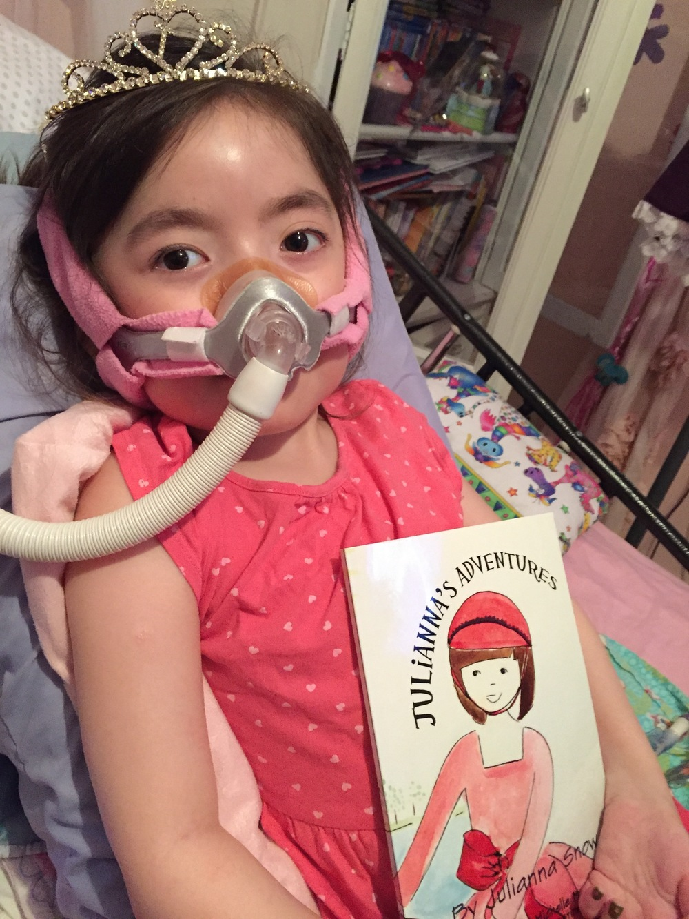 Julianna with her book - photo by Snow family