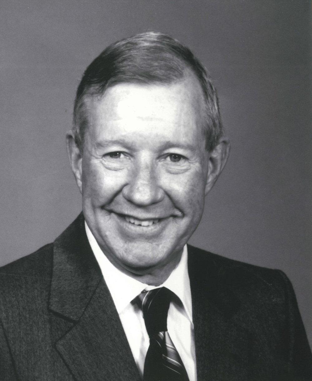 HOWARD E. RUSSELL