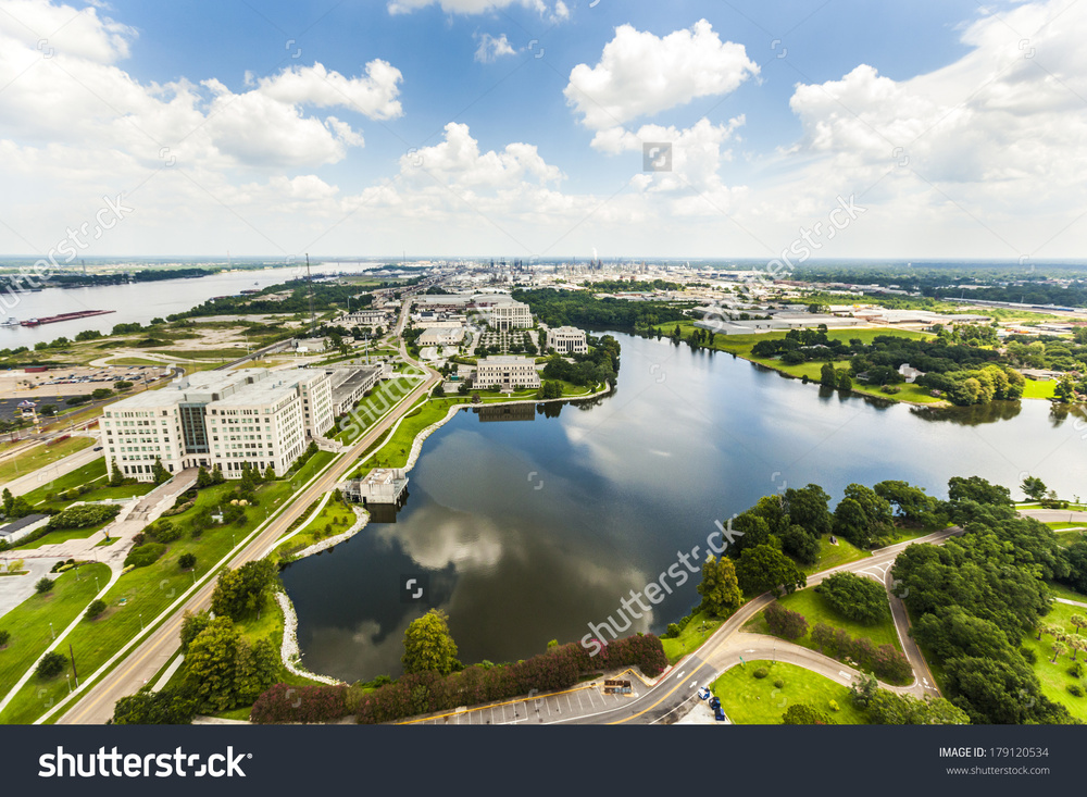 stock-photo-aerial-of-baton-rouge-with-mississippi-river-and-oil-refineries-at-the-horizon-179120534.jpg