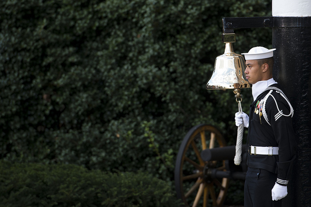 A sailor rang the bell each time the names of a fallen victim of the Navy Yard shooting were read during a memorial ceremony at the Marine Barracks in Washington D.C.  Photo via Erin A. Kirk-Cuomo.