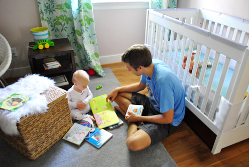 A father reads to his daughter. Photo via blogs.babycenter.com